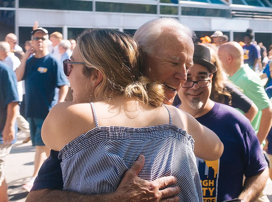 Former U.S. Vice President Joe Biden hugs an attendee at the annual Labor Day parade Downtown.