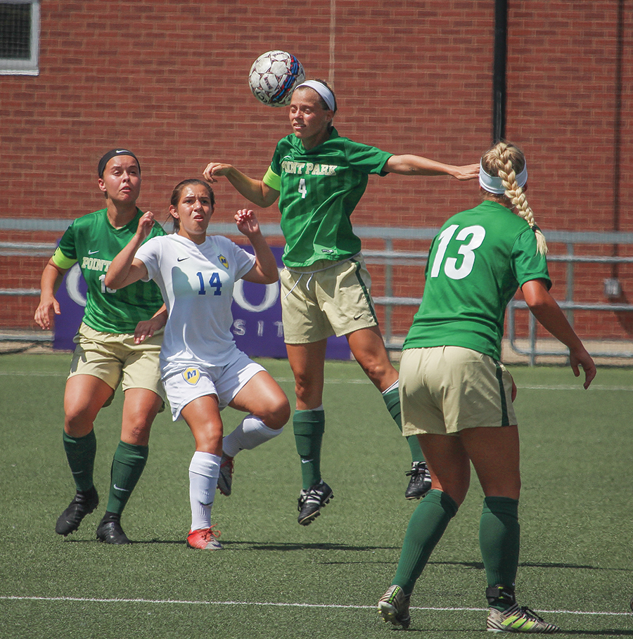 Senior defender Asia Pennock-Franke heads the ball during a match up against Lourdes University earlier this year. The team is now on a seven game win streak after defeating conference opponents Ohio Christian University and Rio Grande University this past week.