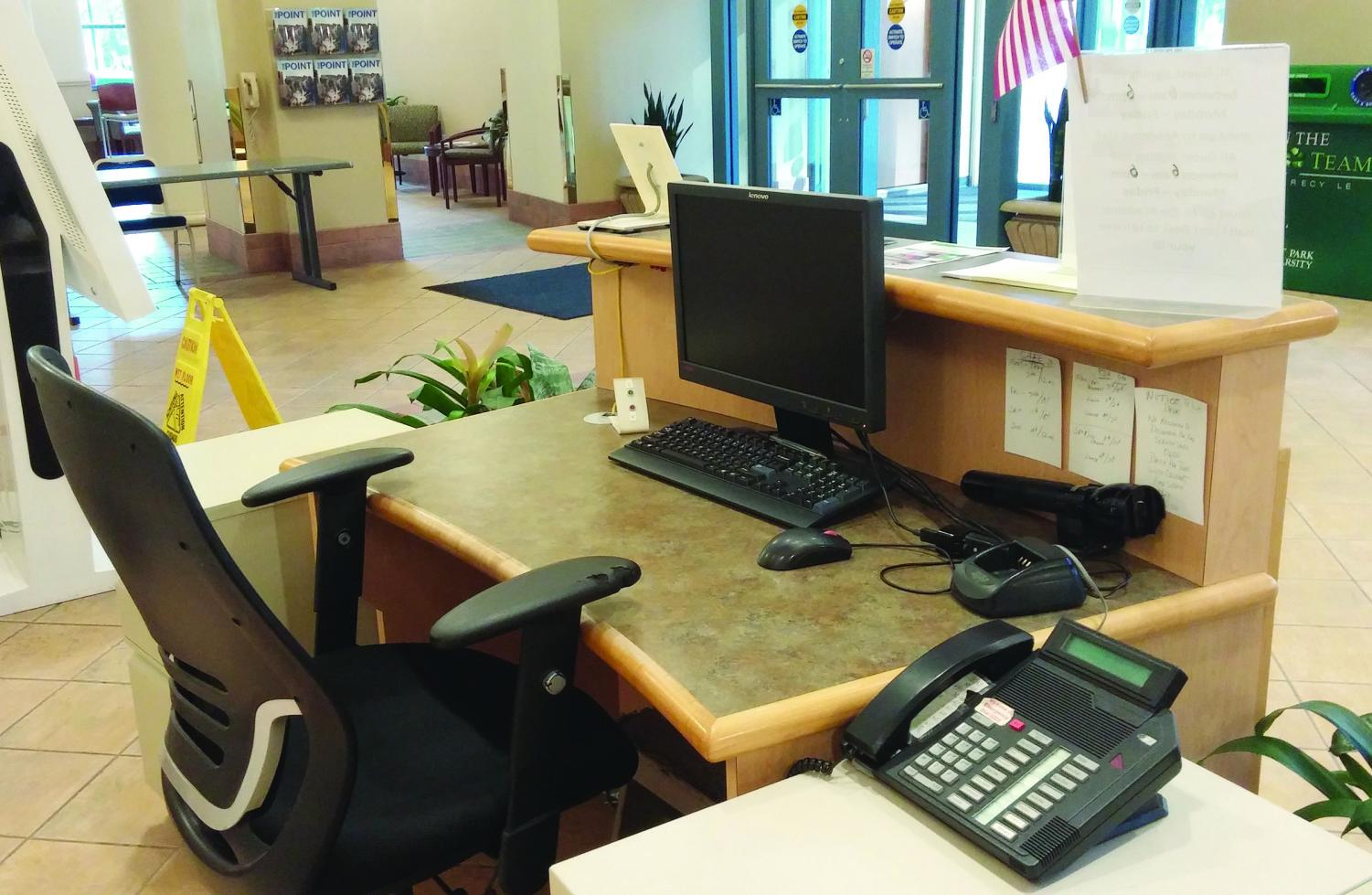 The security desk in the Lawrence Hall Lobby stands empty during daylight hours. Security guards check IDs around the clock in Academic Hall, but not in any of the other buildings on-campus.