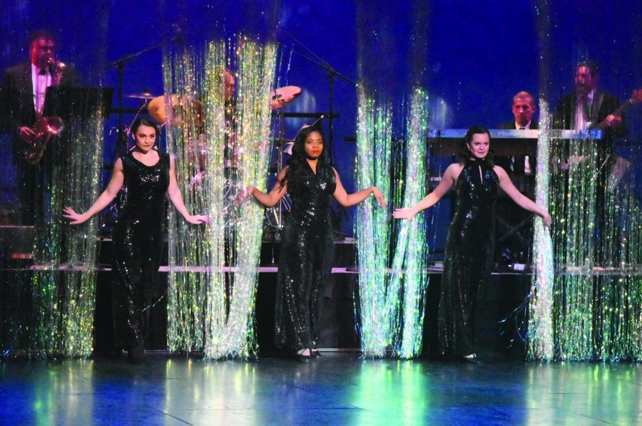 """From left to right: Emily Stoken, Jada Castillo and Hailie Hagedorn perform """"Dancing Queen,"""" as featured in the musical """"Mamma Mia!"""" during the inaugural performance of the Pittsburgh Playhouse."""