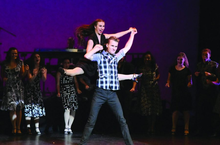 Kurt Kemper, senior musical theater major, lifts sophomore BFA dance major Bailee Brinkman during a performance the Playhouse gala that took placew Saturday.