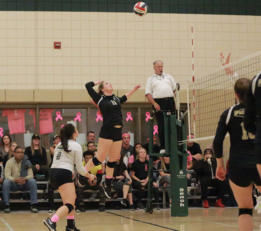 Senior outside hitter Jordan Dixon performs a spike during the team's Dig Pink game Friday night against Indiana University Kokomo. The women lost Friday, but bounced back Saturday night with a win against Cincinnati Christian.