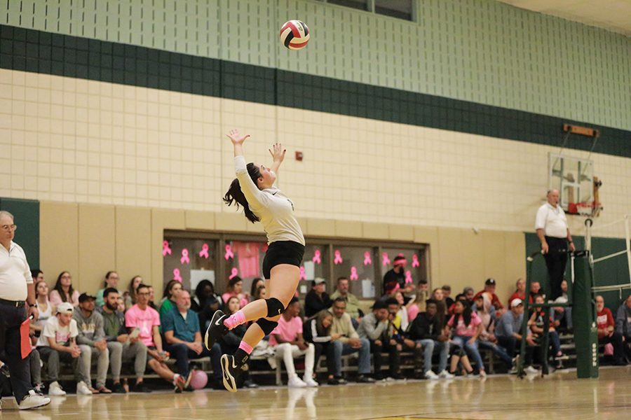 Senior libero Morgan Dangelo makes a serve during the team's Dig Pink game two weeks ago. The volleyball team will take on West Virginia University Tech and Rio Grande University this weekend in the Student Center Gym.