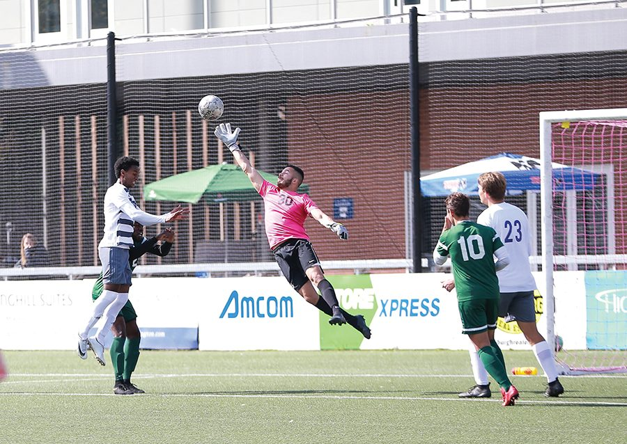 Senior goalkeeper Juan Somoza dives to make a save in a match against  Asbury University. The senior is 5-1-1 in net this season.