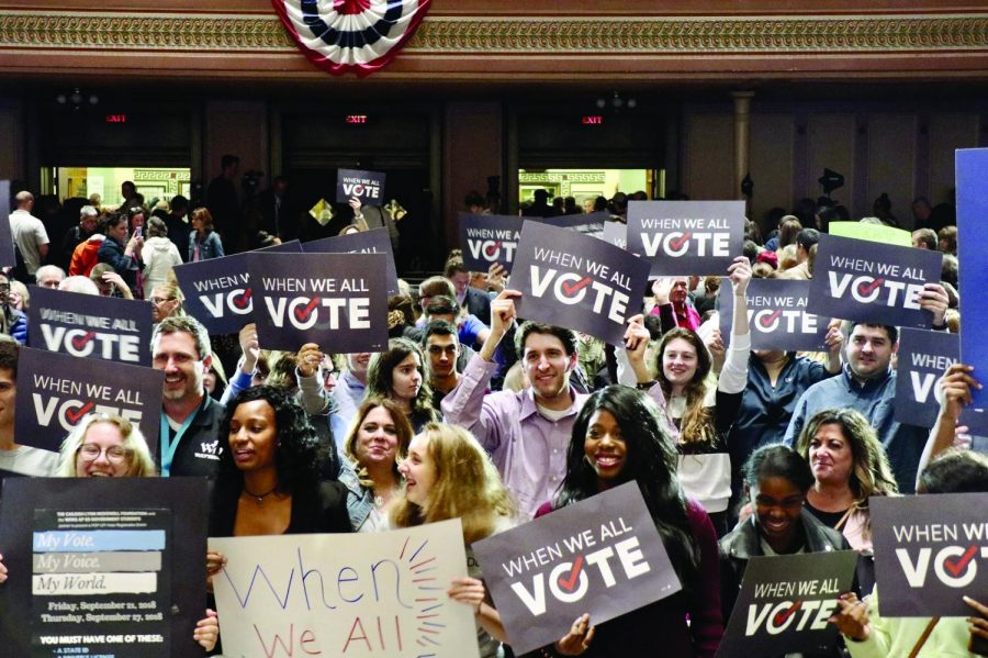 "Pittsburgh locals hold up their ""When We All Vote"" signs and cheer as actor Tom Hanks leaves the stage after delivering an empowering speech. Hanks touched on the importance of participating in our democracy. Students from surrounding Pittsburgh universities came out to see Hanks speak about the importance of voting in the midterm elections, along with other speakers such as Steelers running back James Conner, team executive Jim Rooney and coach Mike Tomlins' wife, Kiya Tomlin. The ""When We All Vote"" rally was organized through the University of Pittsburgh."
