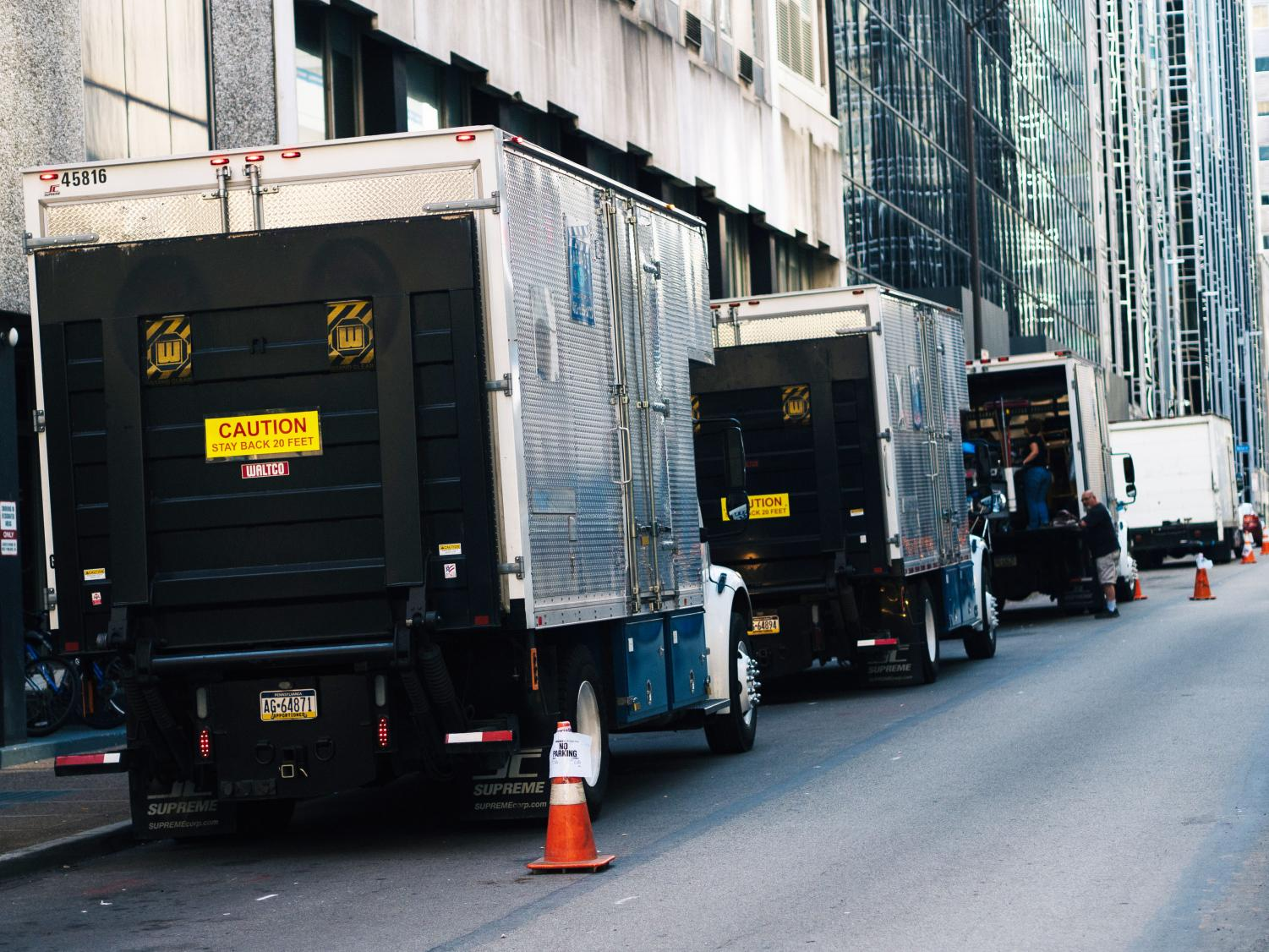 "Trucks line Third Avenue adjacent to Thayer Hall. Production crews took over a block on Wood Street while working on production for ""You Are My Friend,"" starring Tom Hanks as Fred Rogers."