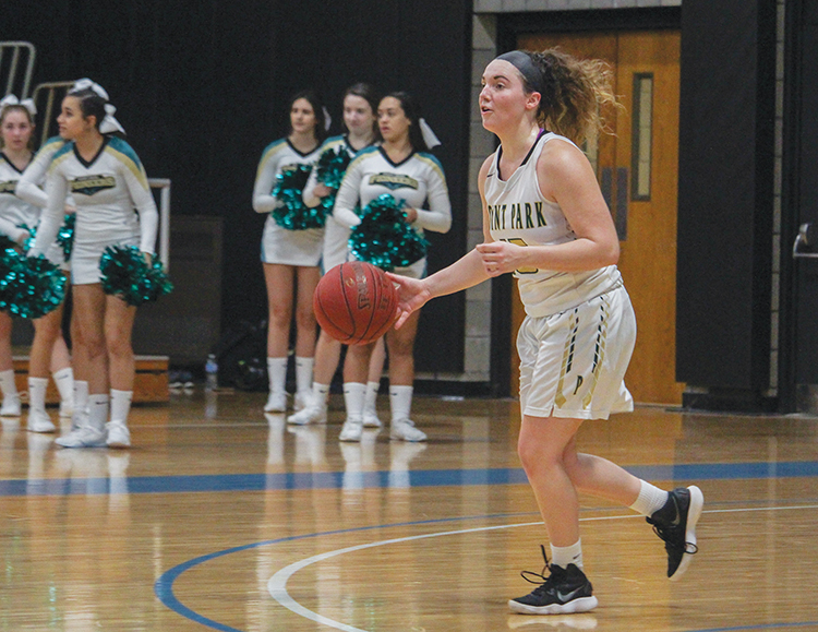 Sophomore guard Michelle Burns dribbles the ball into the offensive zone Thursday night against Ave Maria. The team picked up their first win of the season and Burns had a career high 28 points along with eight rebounds.
