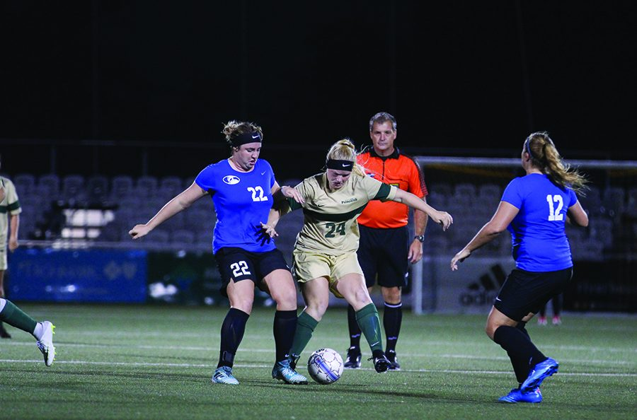 Freshman+midfielder+Britney+Adrian+battles+a+defender+in+this+year%E2%80%99s+contest+against+Ohio+Christan+University.+The+Pioneers+will+host+a+home+playoff+game+Wednesday+night+against+Indiania+University+East.+
