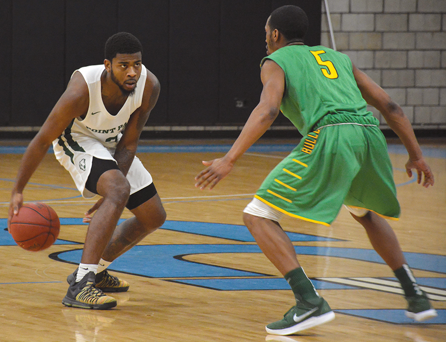 Senior guard Asim Pleas drives toward a defender in a game last year. The team got its first win of the season against Penn State- Shenango Saturday.