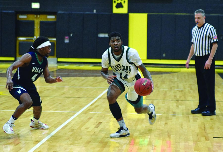 Senior+guard+Asim+Pleas+takes+the+ball+in+the+offensive+zone+during+a+2017+contest.+The+team+dropped+three+games+over+Thanksgiving+break.+