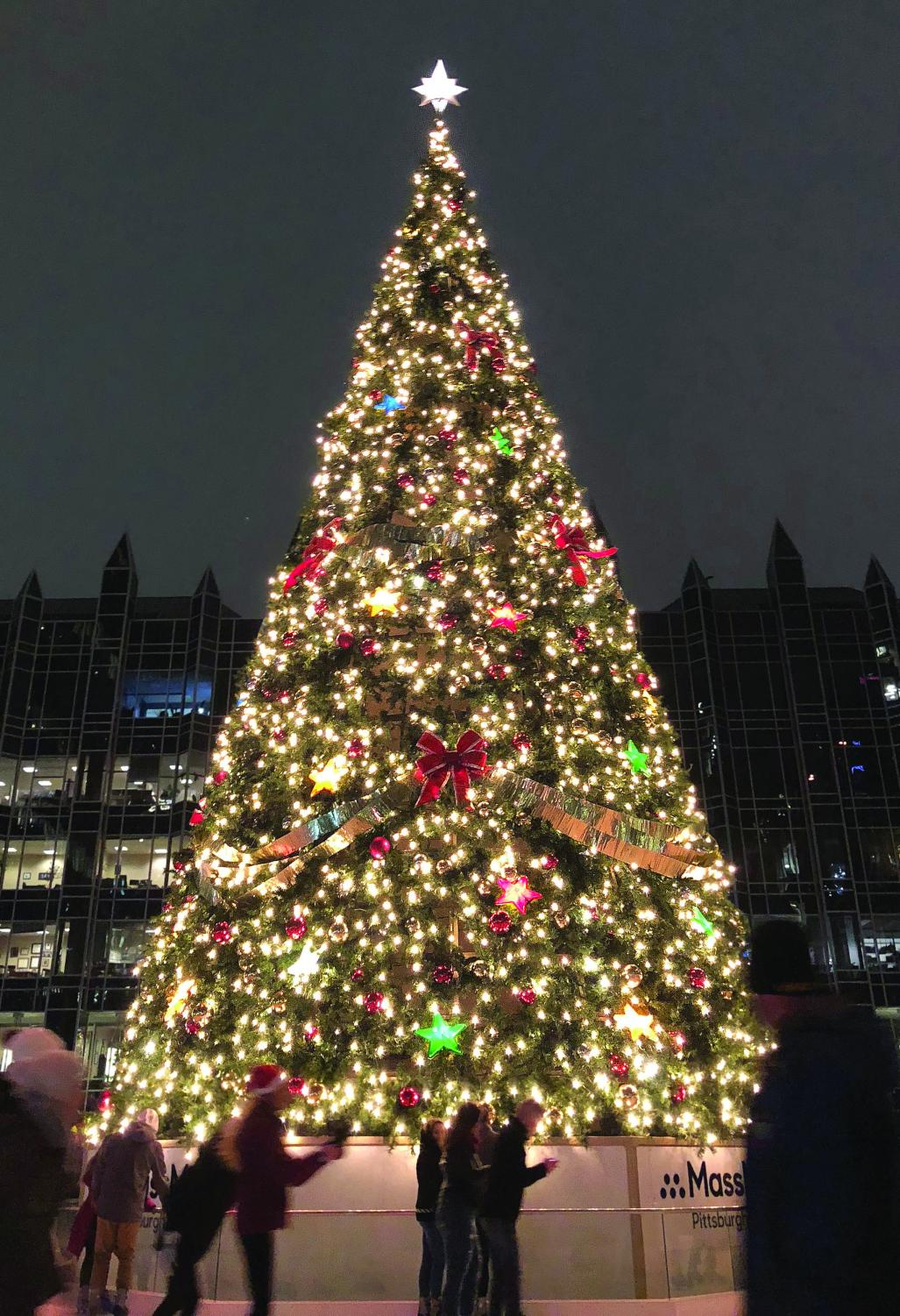 Skaters make circles around the tree at PPG Place during Light-Up Night on November 16.