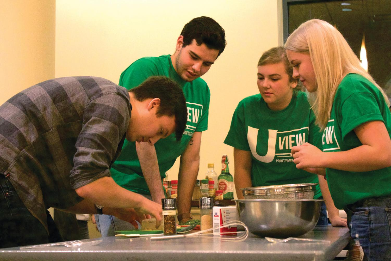 The U View team works to create a risotto with white kidney beans in the second annual chopped competition.