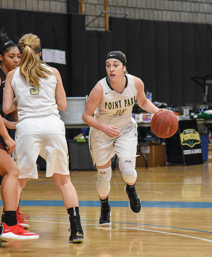 Senior guard Kaitlyn Smith dribbles into the offensive zone against IU Kokomo Saturday afternoon. Smith lead the team in points with 23 but the team lost 77-71 . They continue conference play this Saturday.