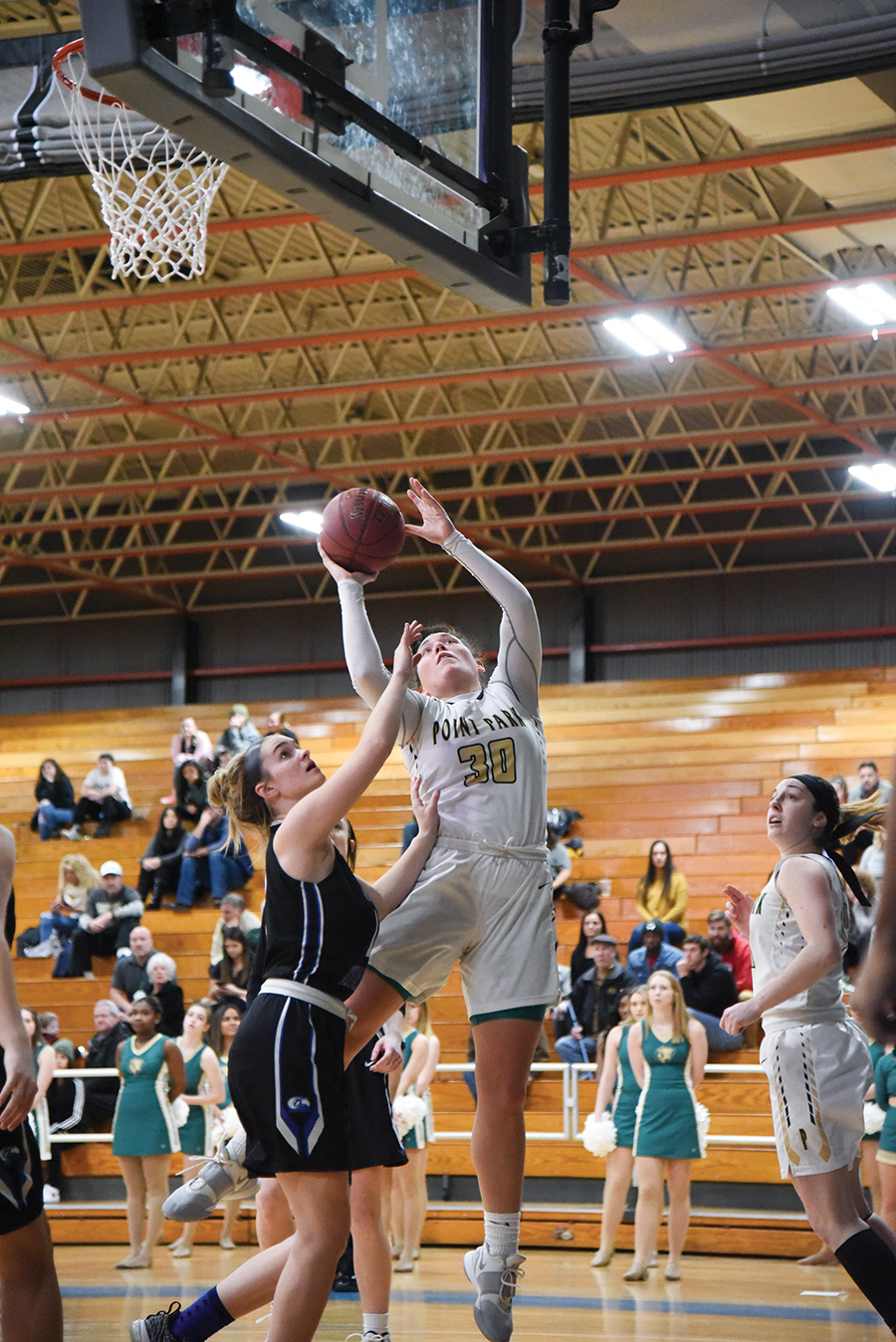Senior power forward Sam Weir goes up for a shot against a defender during Saturday's matchup against Ohio Christian. In this game, Weir put up 30 points, which is one away from tying her career-high, 17 rebounds, which is three away from tying a career-high, and five blocks.