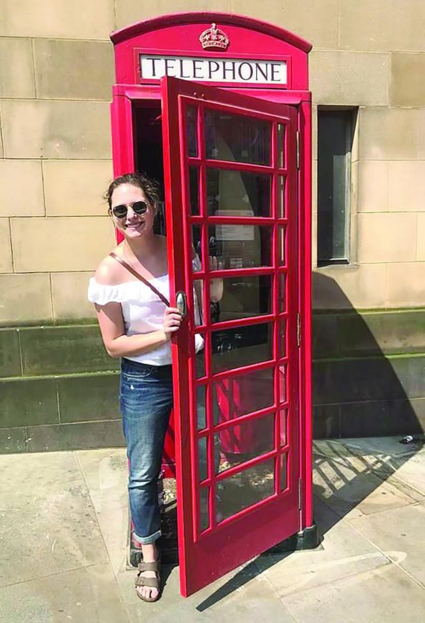 Hattie Charney, junior broadcast reporting and journalism major, poses in a telephone booth during her time studying abroad in the United Kingdom.