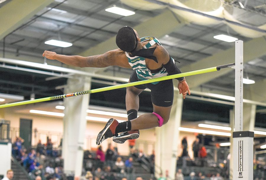 """Michael Morris competes in the high jump last Saturday in Tiffin, Ohio  at the RSC Indoor Track and Field Championship. Both teams won the RSC title. """"We overcome so much here at Point Park... It's a challenge without having facilities and  to overcome that, winning a championship makes it a little sweeter"""" coach Kelly Parsley said."""
