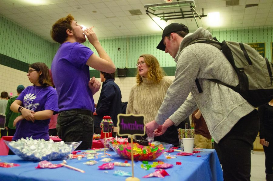 """Campus Activity Board sponsored the annual Condom Carnival in the Student Center on Feb 13. The organization set up a """"candy bar"""" in the middle of the gym filled with games, condoms and a giant bouncy house."""