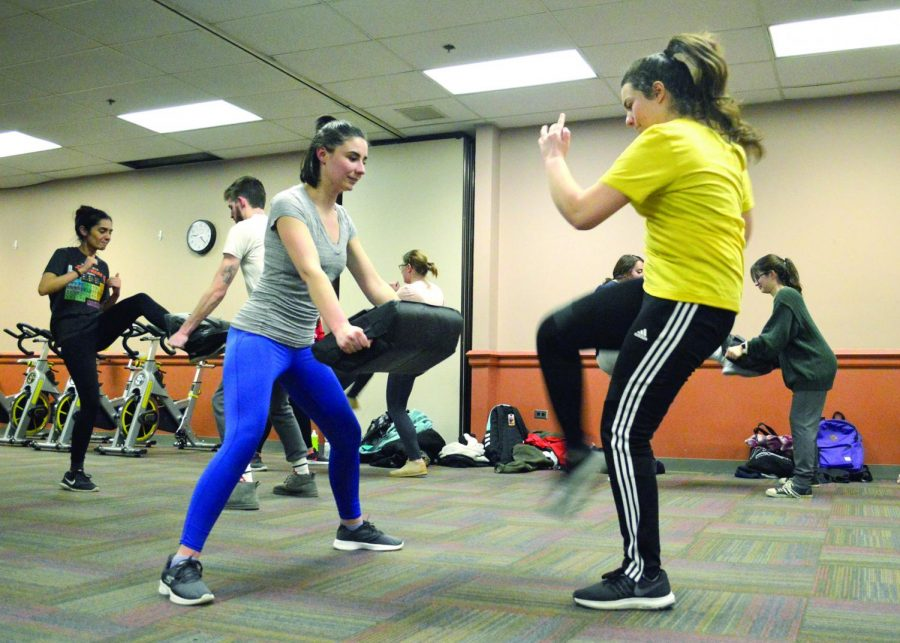 Future Educators of America practiced Krav Maga, an Israeli military form of self-defense. The class brought 22 students into the Student Center Tuesday evening to learn from Kathy Kluk, who has practiced the form for 11 years and is a certified trainer.