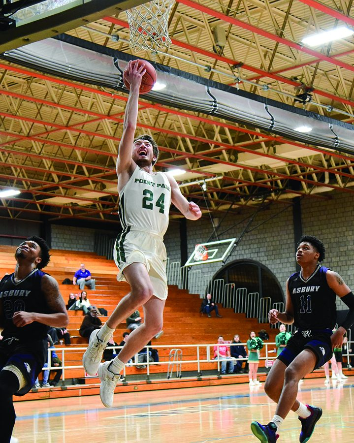 Junior guard Chance Wright attempts a layup against Asbury University last month. Wright scored 13 points last week against WVU Tech.