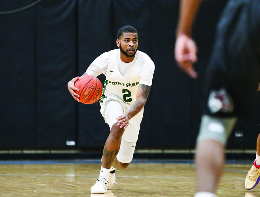 Senior guard Asim Pleas dribbles the ball during his senior night game against IU East last week. The team fell 87-67, but Pleas ended the game with nine points.