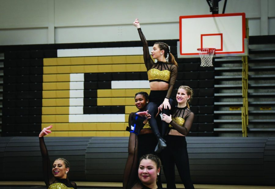 The competitive dance team competes at Gateway High school as part of the Pioneer Preview last month. The team placed second last weekend while competing at Aquinas College.