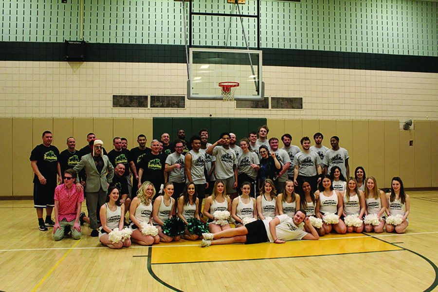 Members+of+the+Competitive+Cheer+and+Dance+team+pose+with+the+students+and+faculty+who+competed+in+the+Hoopla+basketball+game.+The+students+defeated+the+staff+to+a+score+of+58-45.+