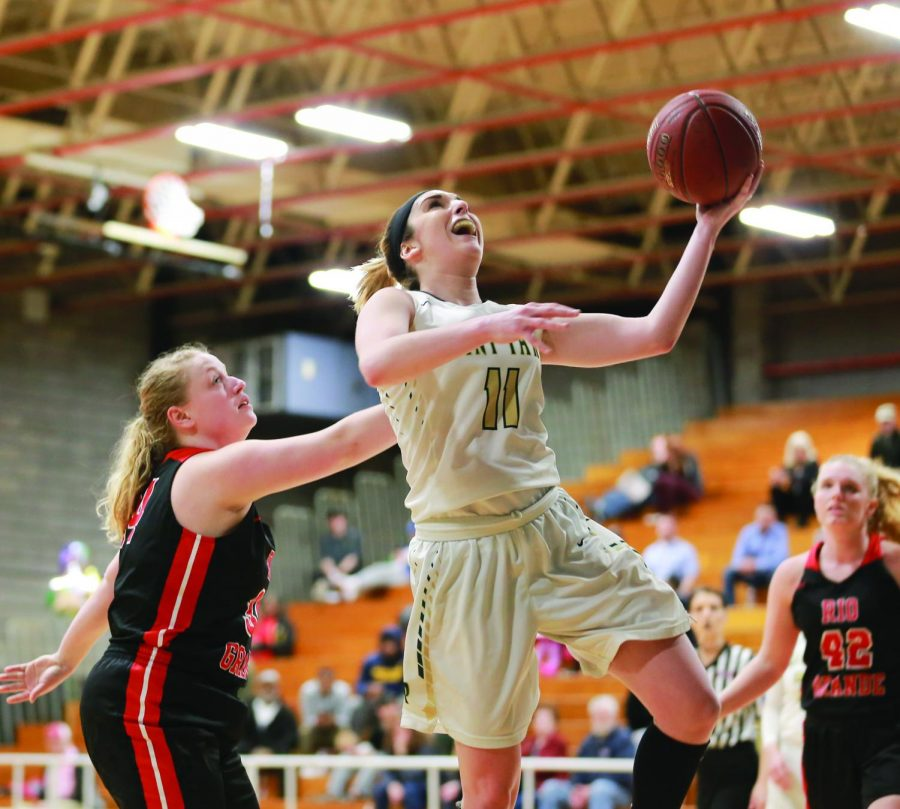 Senior guard Kaitlyn Smith attempts a layup during her senior night contest against Rio Grande. The Tuesday before Spring break, Smith put up 12 points in the team's road playoff loss to IU Kokomo.