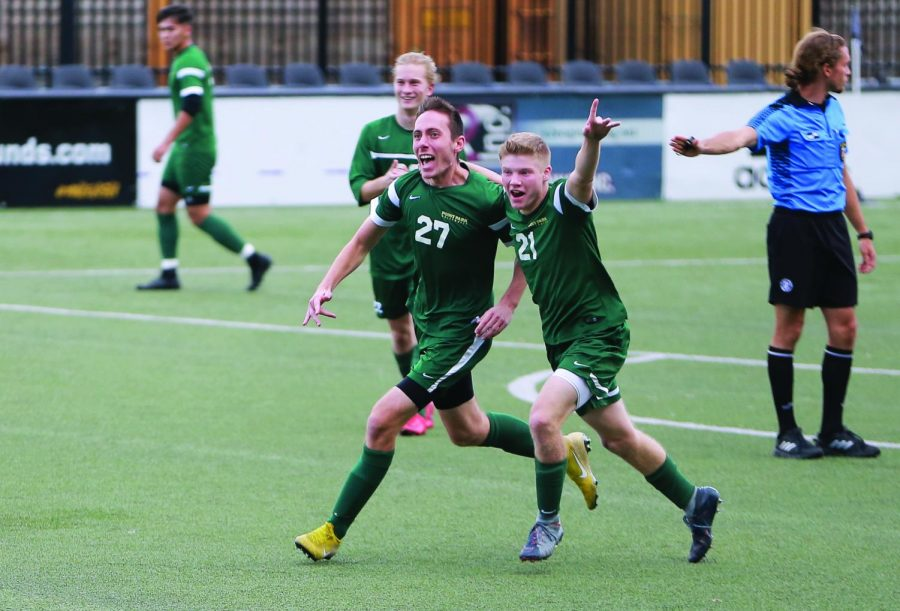 Sophomore Christopher Ciucanu (left) celebrates a goal last season.