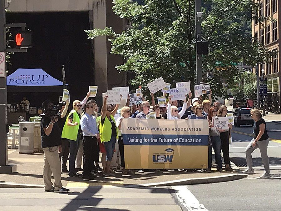 Adjunct+faculty+protest+at+the+corner+of+Village+Park+during+move-in+on+Aug.+19.