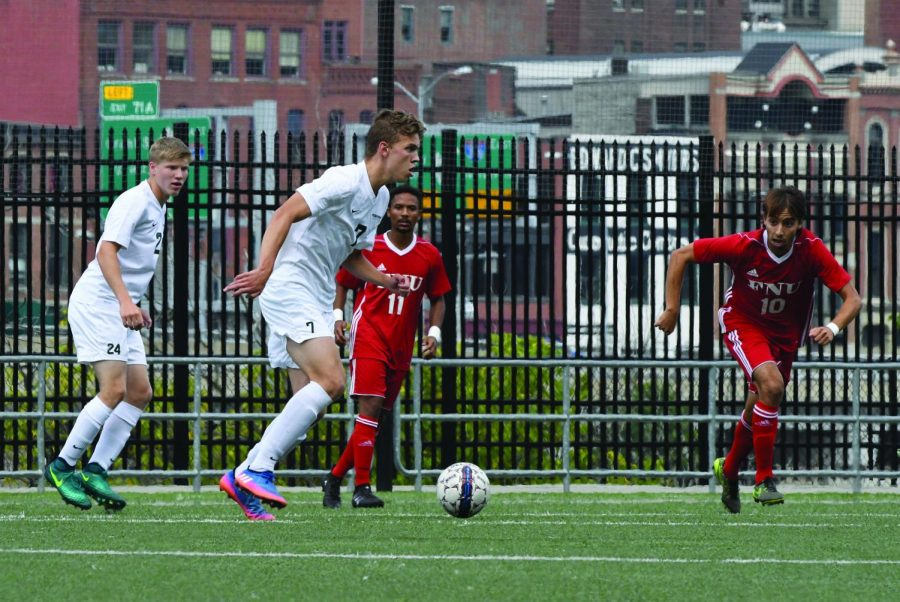 Now-senior Wessel Rietveld advances the ball down the field with now-junior forward Mitchell Roell close behind.