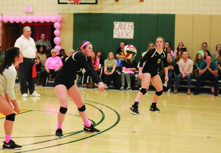 Ashley Castelli, now a sophomore, prepares to pass a ball in the breast cancer awareness match last season in the Student Center.