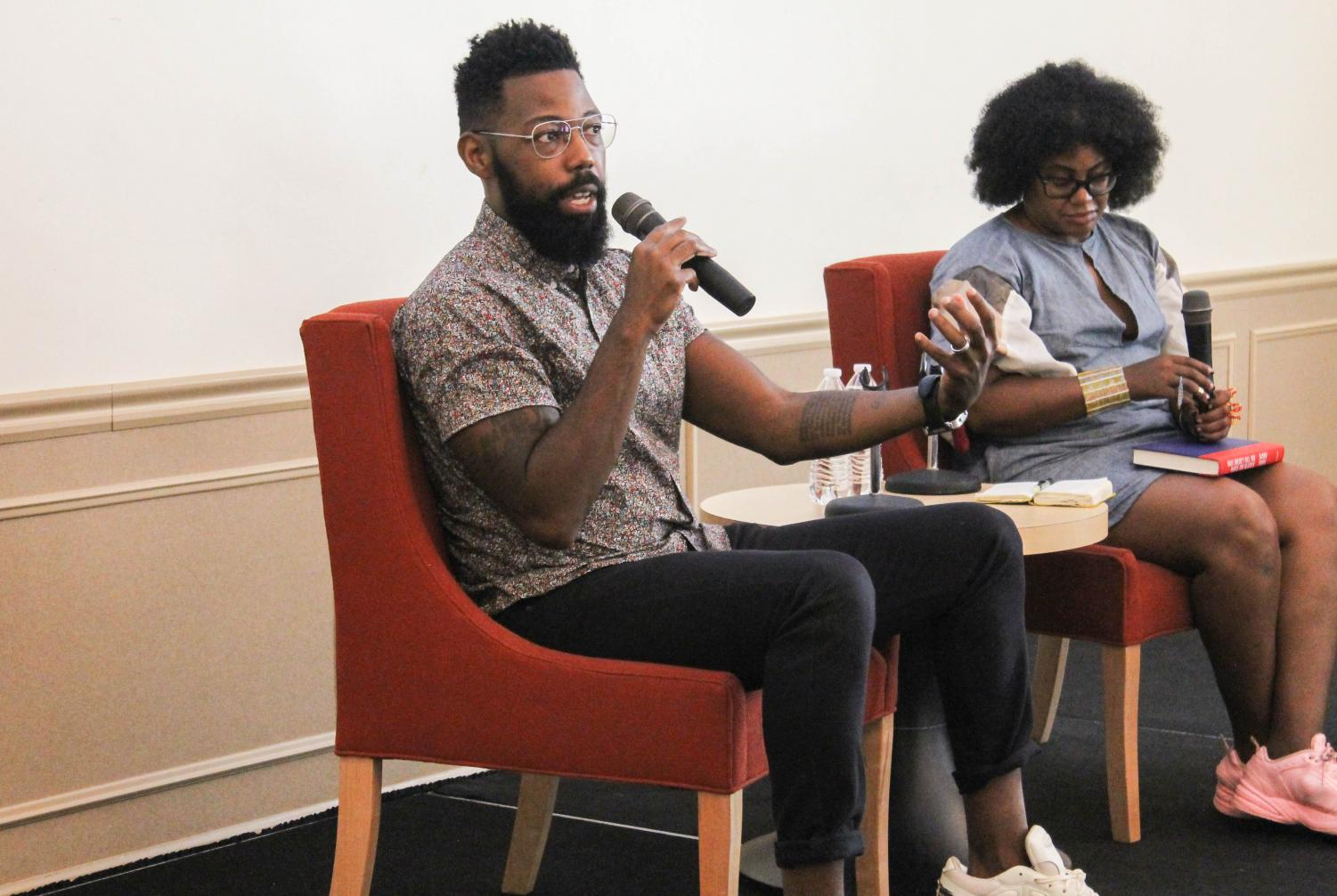 """Damon Young speaks in Lawrence Hall 200. He discussed his new book """"What Doesn't Kill You Makes You Blacker: A Memoir in Essays,"""" which takes a look at his experiences as a black man in America."""
