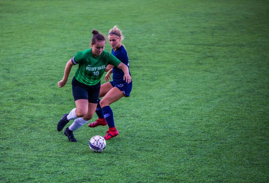 Senior captain Gabby Widman chases the ball around a defender against Shawnee State University at Highmark Stadium. The Pioneers lost the close matchup 2-1.