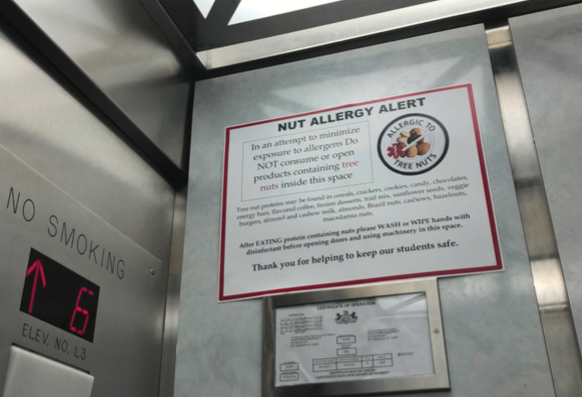 """""""NUT ALLERGY ALERT"""" signs have been posted in all elevators and lobby of Lawrence Hall."""