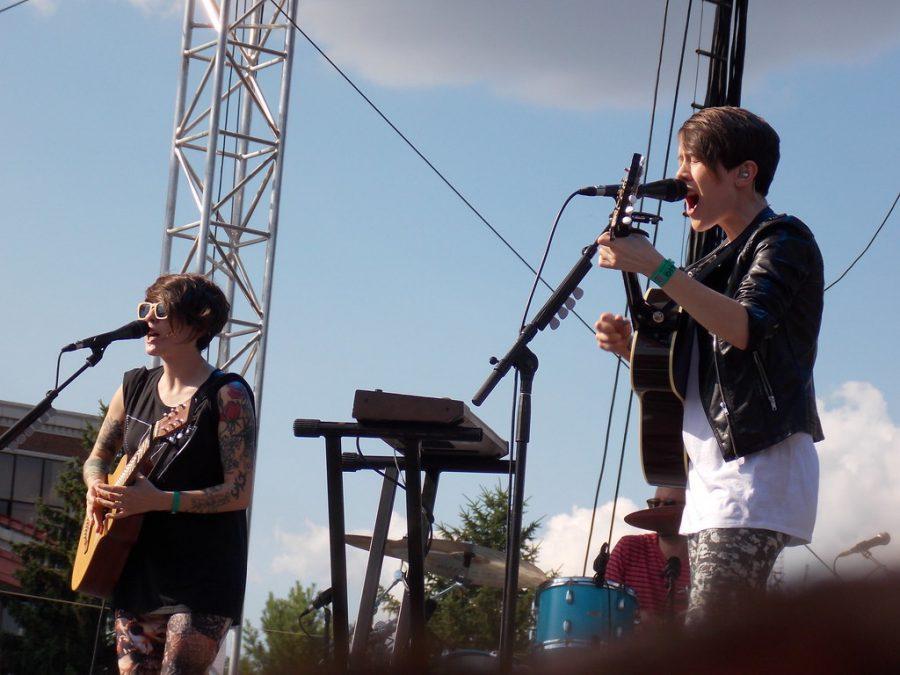 Tegan and Sara perform on stage.