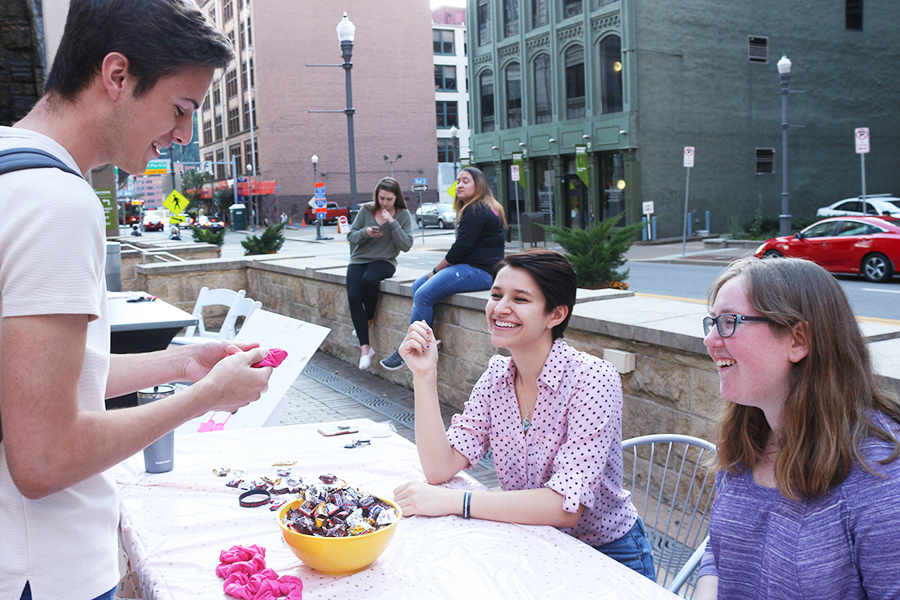 Tyler Levesque (left), Vitoria Garcia (middle) and Sara Buchdahl (right) participate in Pinknic, one of the Honors Student Organization's month-long Pink Feet events. Proceeds went to the Susan G. Komen Foundation.
