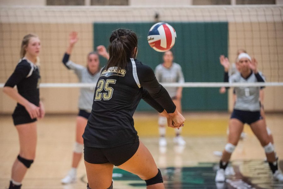 Senior Haley English returns a serve in a match held in the Student Center gym two weeks ago.