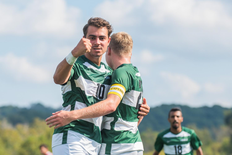 Junior midfielder Geert Bijl celebrates a goal against with junior forward captain Mitchell Roell. Bijl scored twice in the RSC opener.