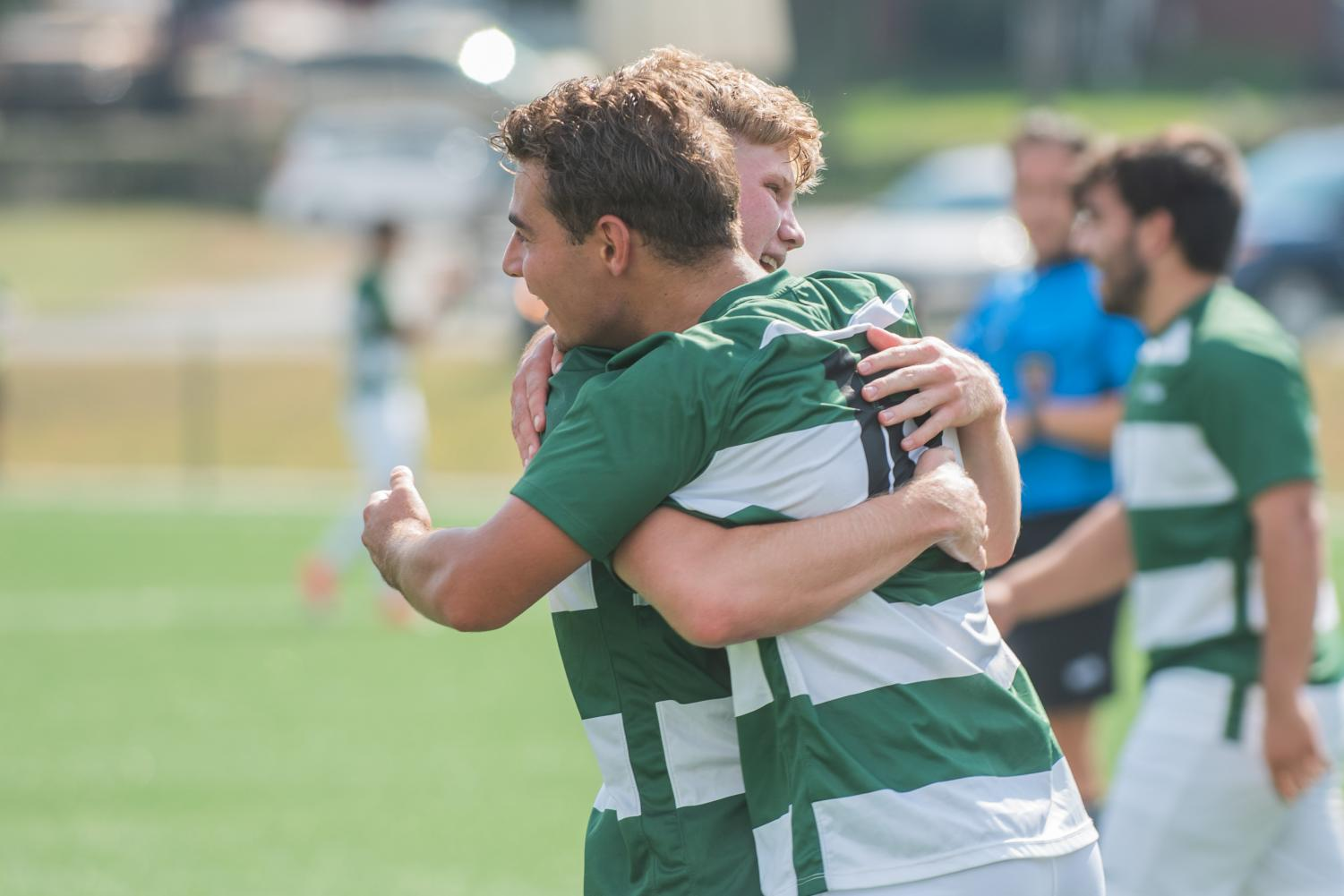 Juniors Mitchell Roell and Geert Bijl celebrate a win with a hug in a game at the Montour Junction Sports Complex. The celebration continued when the team beat the school record for most wins in a season.