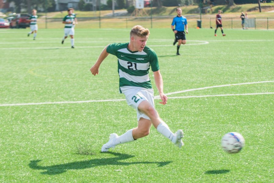 Junior forward Mitchell Roell takes a shot on goal. Roell scored the first of two goals for Point Park in Monday's game at Rio.
