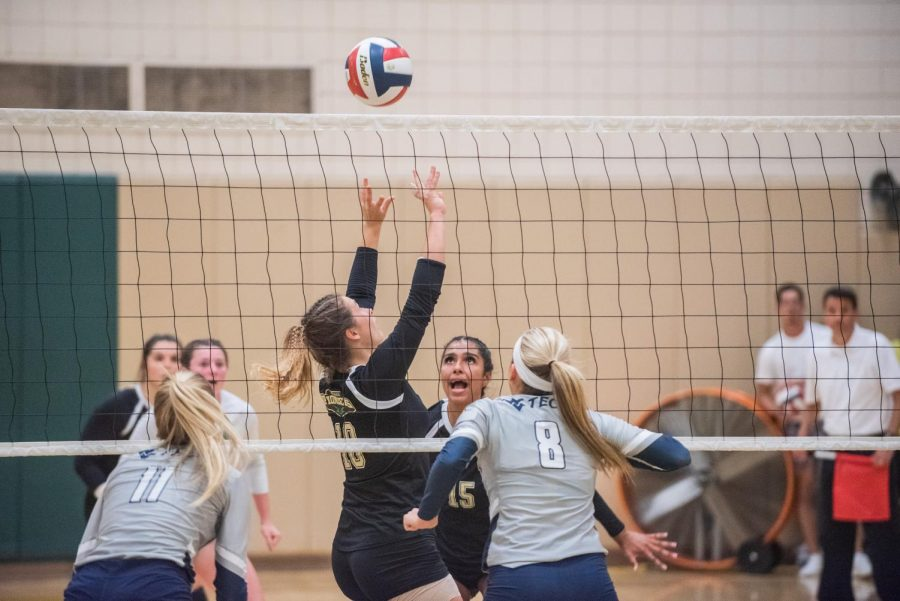 Senior setter Julia Menosky (left) sets up a kill for junior Jazlyn Rozier in a match against WVU Tech earlier this season.