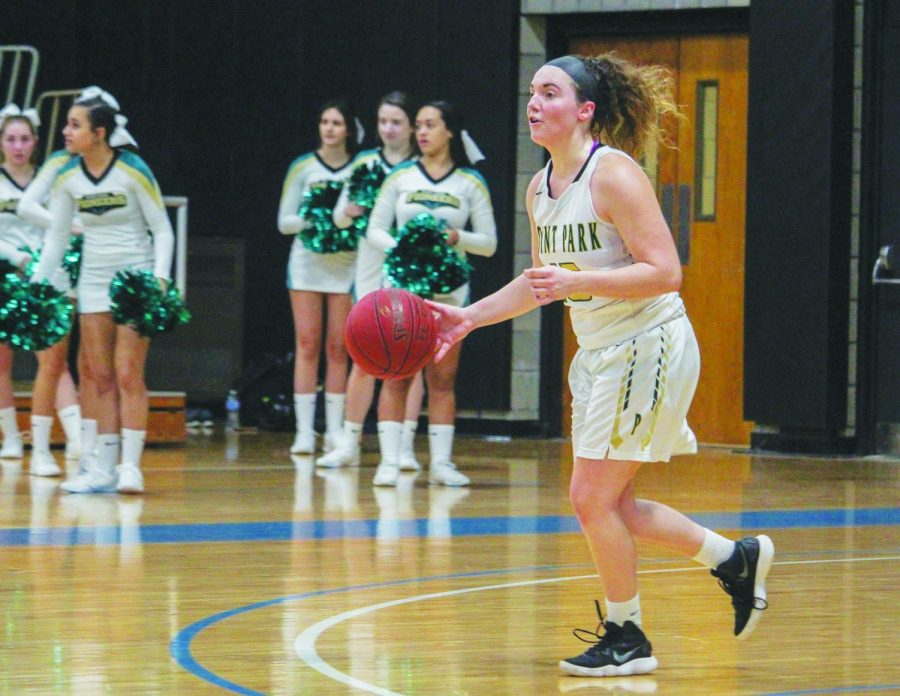 Now-junior Michelle Burns sets things up from the opposite side of the court during a game last season.