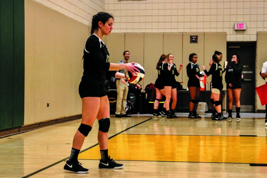 Senior Brittney Bianco get ready to serve the ball in Saturday's matchup against Ohio Christian University.