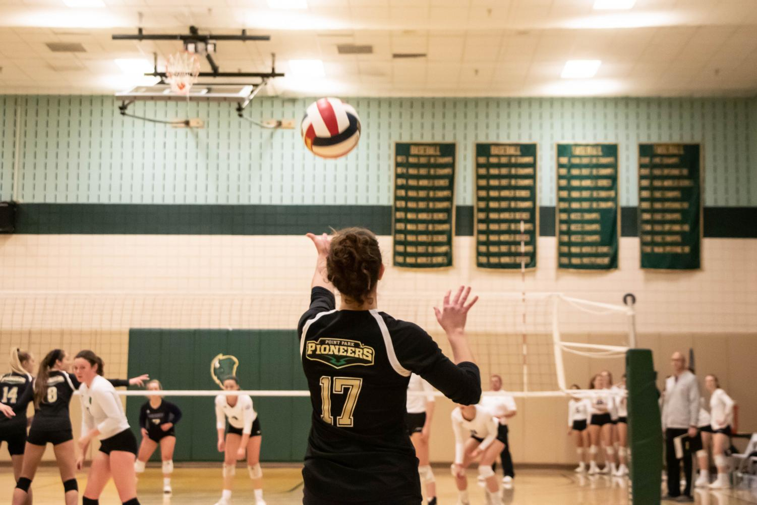 Senior Brittney Bianco gets ready to set the ball in a set against Asbury in the student center gym on Friday.