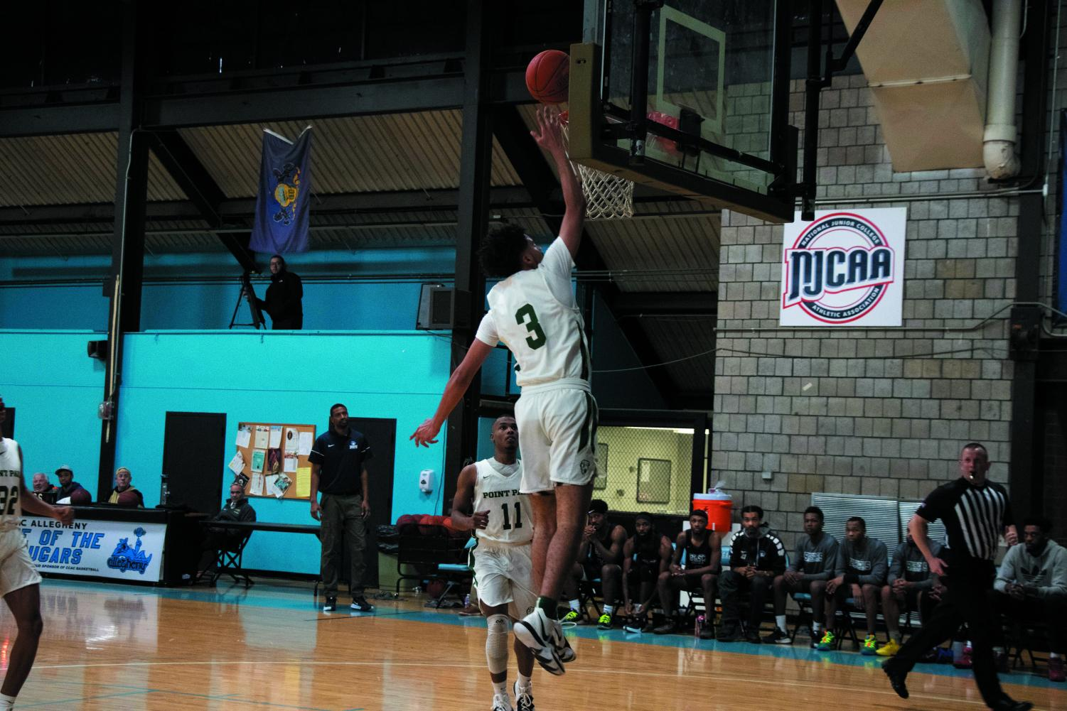 Sophomore guard Sherron Schi no goes up for an uncontested lay- up in a game against Bryant & Stratton-Buffalo last week.