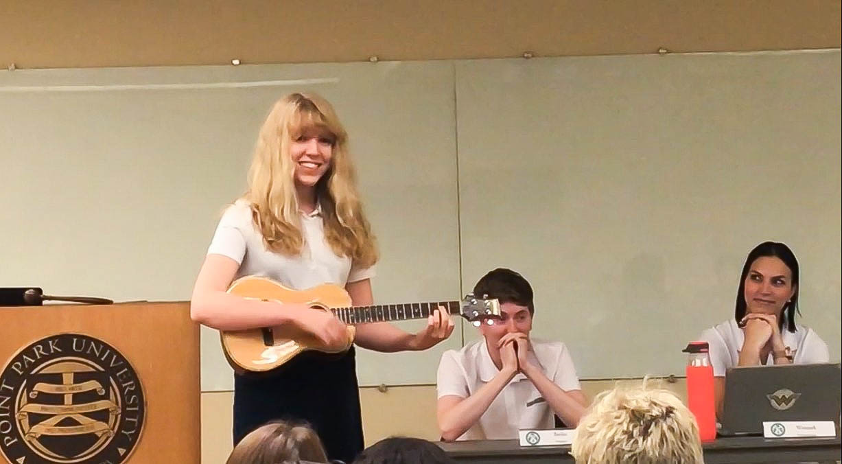 USG Vice President Alexa Lake plays the ukulele during her censure trial at Monday's meeting.
