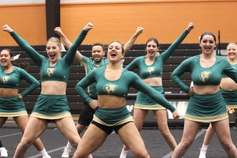 Cheer team wins big at home, places on road