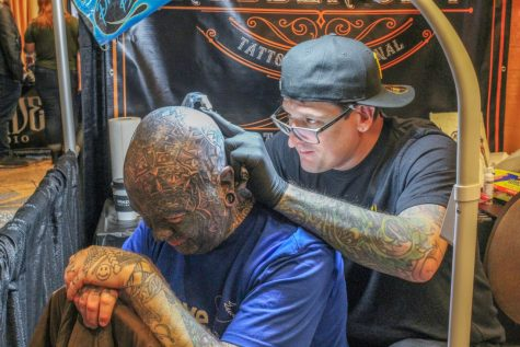 Tony Urbanek tattoos a client, a Point Park alum, at the Pittsburgh Tattoo Expo on Sunday, March 8. Urbanek owns Inkadinkadoo Tattoo Studio in Pittsburgh