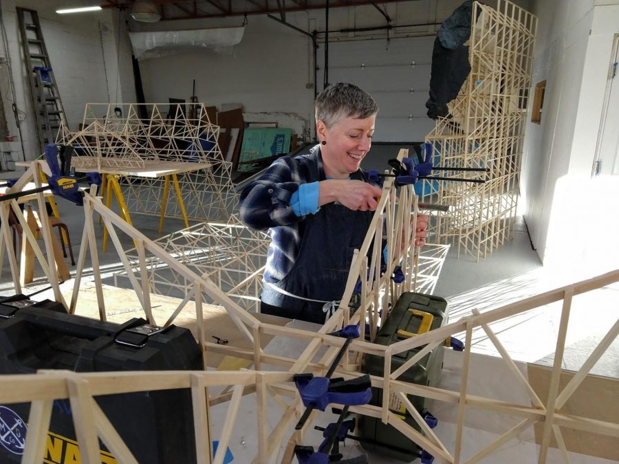 Mincemoyer works on creating the art installation. Photo Credit: Carin Mincemoyer