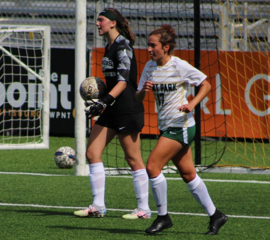 Josie Valeri and Gillian Beirhals clear the ball from their zone.(Photo Credit: Sports Photography Editor Grace Balzer)